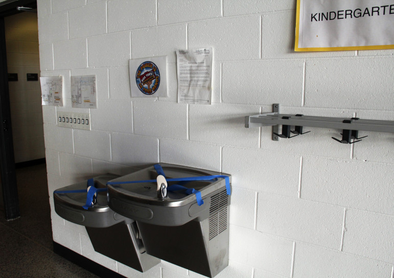 Water fountains are taped over at Yorkville Elementary School in Racine County due to high levels of the metal molybdenum. Clean Wisconsin alleges that coal ash buried in a school construction site is partly to blame. Photo by Cole Monka / Wisconsin Center for Investigative Journalism.