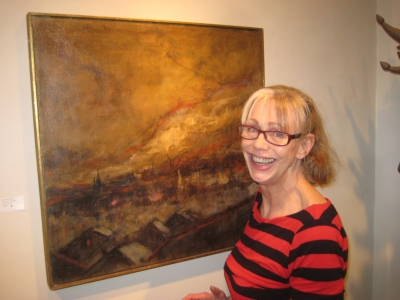 Elaine Erickson with a Joseph Friebert painting. Photo by Michael Horne.