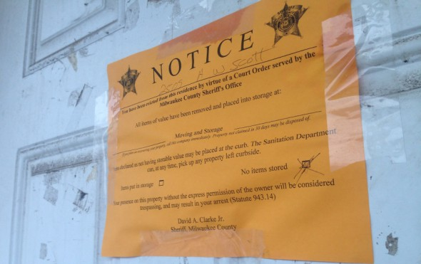 An eviction notice is taped to the door of 2509 W. Scott St. Photo courtesy of Milwaukee Neighborhood News.