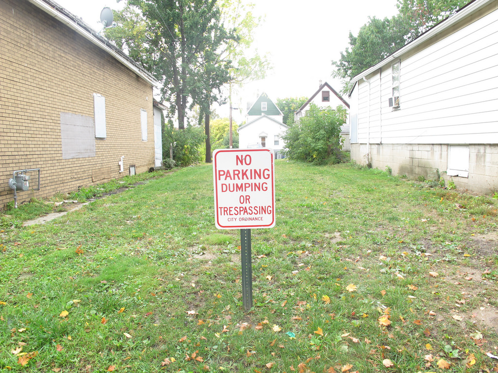 The sign on the lawn of 1119 W. Mineral St. makes it clear that the city has demolished this property and wants the public to steer clear.