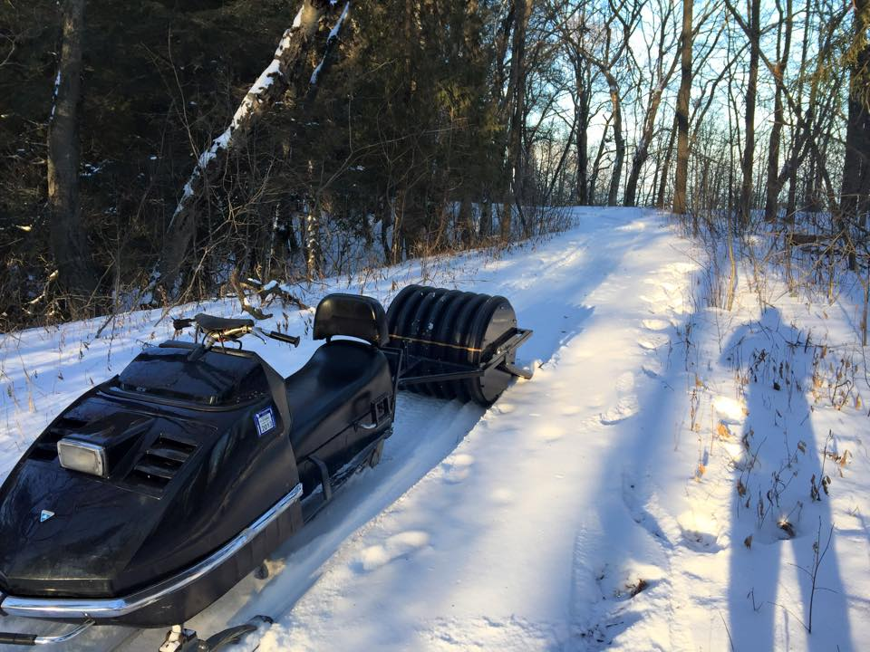 The new groomer behind a sled.