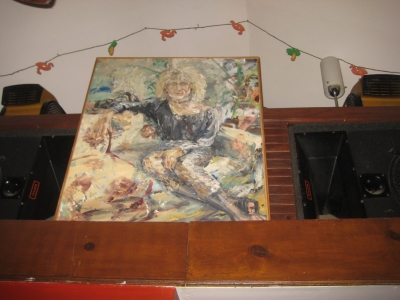 Painting of Mark Smukalla, attired, as was his custom, in women's clothing. Photo taken by Michael Horne.