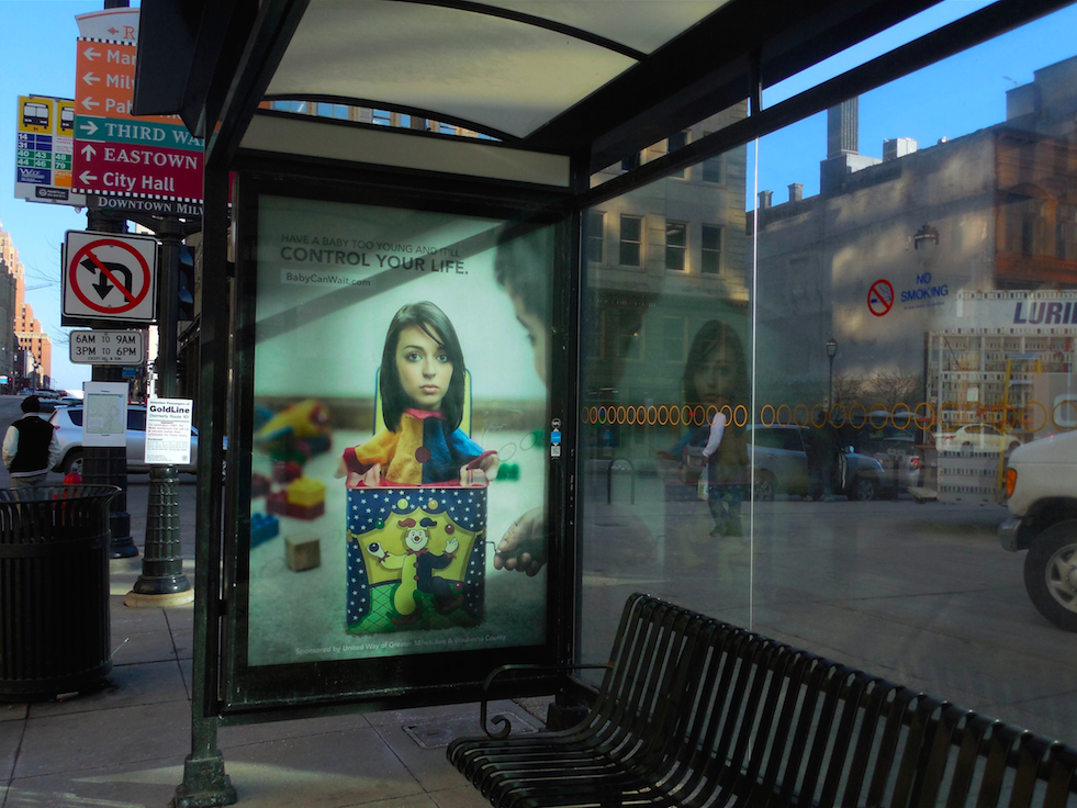 "The new ads are located at bus shelters in targeted areas and read ""Have a baby too young and it'll control your life."" (Photo by Maria Corpus)"