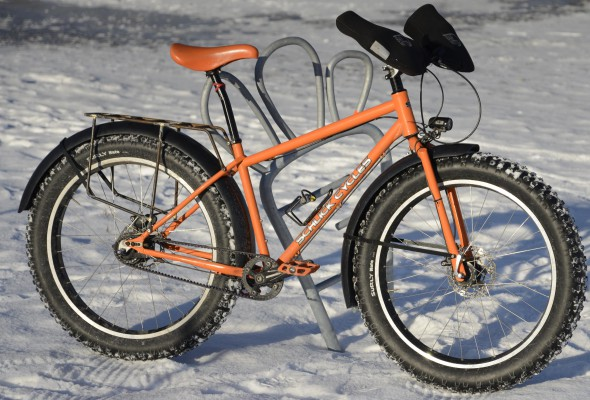 Now that I have a second fat bike, I keep this one set up with fenders and rear rack. Shown here it has Surly Nate tires, but I am currently running 45Nrth Dillenger studded sneakers. I swap the studded tires for Endomorphs in the summer and this becomes my beach bike. Photo by Dave Schlabowske.