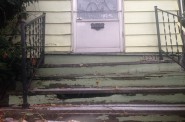 The stairs leading up to 1231 S. 24th street are crooked, chipping and cracked.