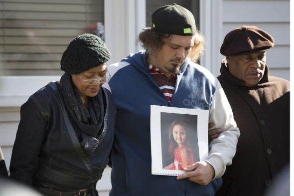 Robert Petersen holds a photo of his 5-year-old daughter, Laylah, who was killed Nov. 6 in Milwaukee while sitting indoors on her grandfather's lap. (Mark Hoffman/Milwaukee Journal Sentinel)