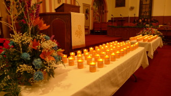 Candles with names attached, at a Dec. 30 memorial in Milwaukee for victims of gun violence there. (Chuck Quirmbach/Wisconsin Public Radio)