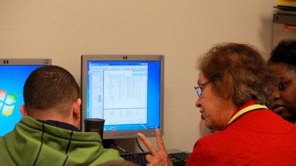 Carole Jameson, a part-time GED instructor at UMOS, teaches a student. (Photo by Molly Rippinger)