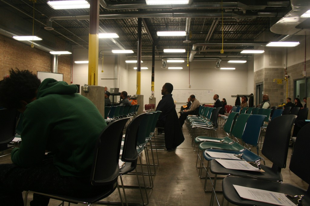 Empty seats litter the after-work information session, which drew less than 20 people. (Photo by Jabril Faraj)