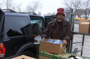 Rev. Isaac Askew of the Temple of the Holy Spirit makes a pickup for his community food pantry at Feeding America, an initiative created by the Milwaukee Rotary Club. (Photo by Matthew Wisla)