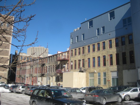 This image of the Commission Row buildings, on the left and viewed from the alley, shows where the proposed addition would be added. Photo by Michael Horne.