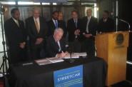 Mayor Barrett signs into law the Streetcar legislation. Photo by Michael Horne.