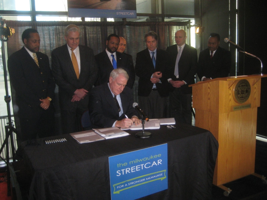 Mayor Barrett signs into law the Streetcar legislation. Photo by Michael Horne.