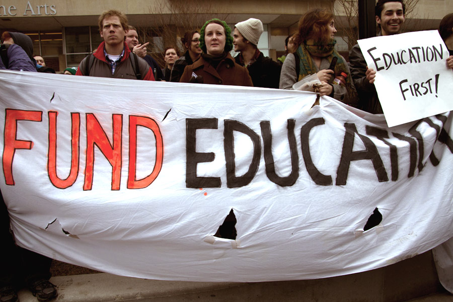 A protest over cuts to education during the passing of Act 10. Recently, Gov. Walker compared the cuts to the UW System to Act 10. Photo taken in February 2011.