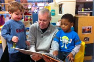 Bill Bravener reading to children. Photo courtesy of the Penfield Children's Center.