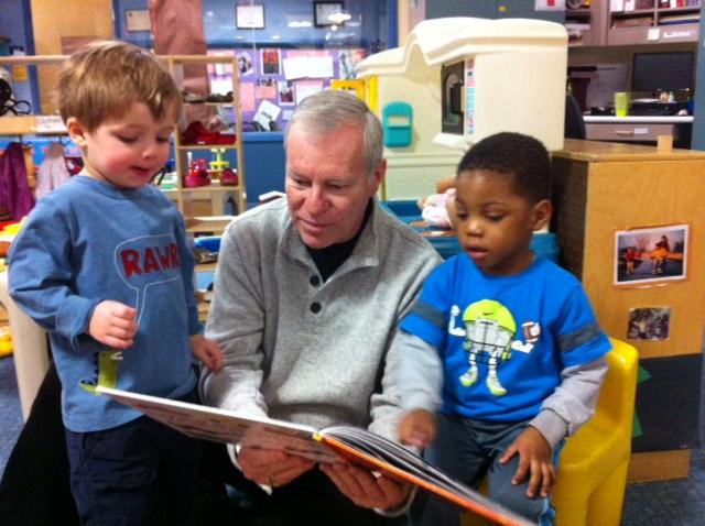 Bill Bravener reading to children. Photo courtesy of the Penfield Children's Center.