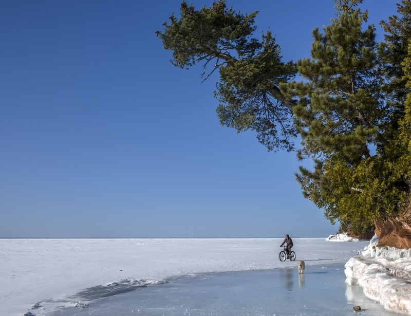 The scenery along the coast of Lake Superior is spectacular any time of year, but riding studded tires on frozen water makes it a little more special. Teddy the dog brought his own studs.