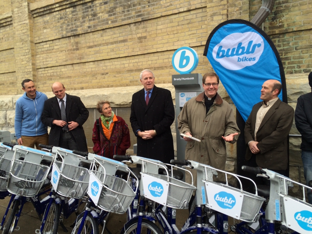 """Blessing of the Bublrs"" Celebrates Bublr Bikes' First Residential Station, on Brady Street"