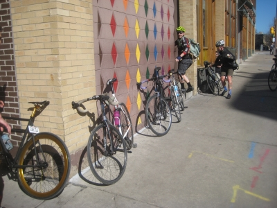 Bikes are lined up at the checkpoint at This is It, 418 E. Wells St. Photo by Michael Horne.