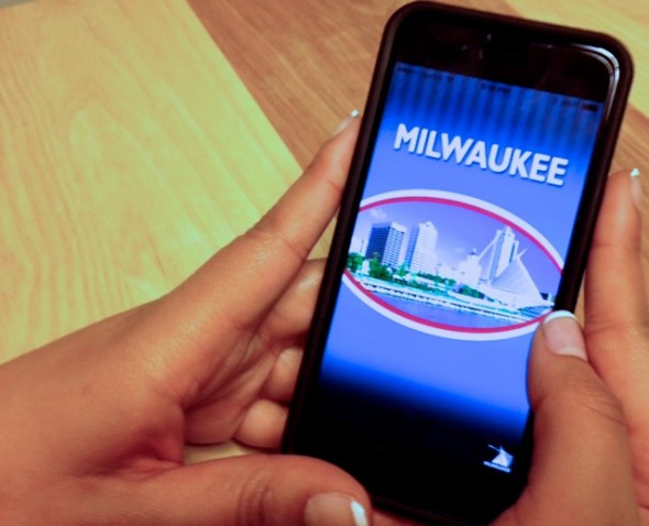 The free app is a fast way for residents to report issues to the city, officials say. (Photo by Maria Corpus)