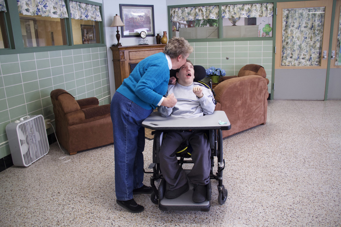 "Rebecca Underwood's son Aaron has lived at Central Wisconsin Center, one of the state's centers for the developmentally disabled, for more than 30 years. She says the care the center provides its patients and their families ""turns their lives around."" Photo Feb. 25, 2015, in Madison. Photo by Kate Golden/Wisconsin Center for Investigative Journalism."
