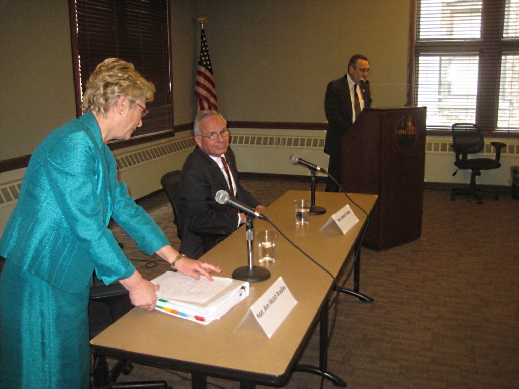 Supreme Court Justice Ann Walsh Bradley  and challenger James Daley, a Rock County Circuit judge and Chief Judge of the 5th Judicial Circuit, who is challenging incumbent prepare for the forum. Photo by Michael Horne.