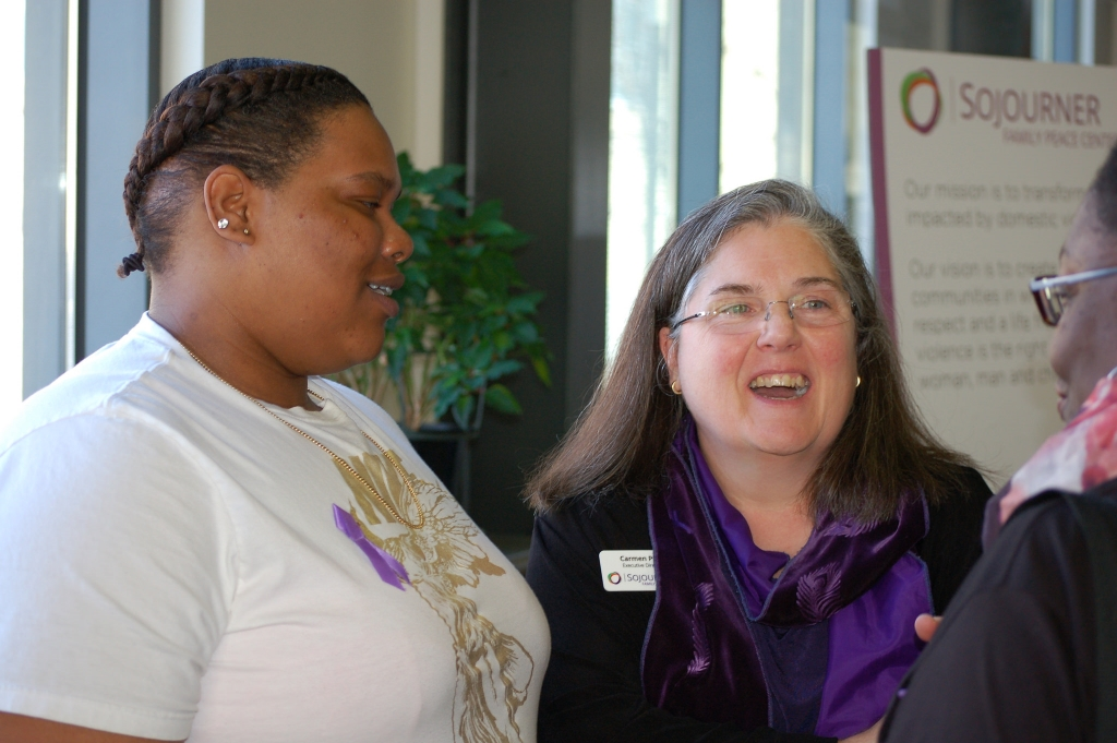Garada (left), who requested that her last name not be used, shares a light moment with Carmen Pitre (center), executive director of Sojourner Family Peace Center, and Dolly Grimes-Johnson, shelter and services director. (Photo by Andrea Waxman)