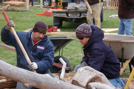 Rolando Morgado Sanchez (left) and Michael Peterson of the Wisconsin Landscape Contractors Association build a balance beam out of tree trunks and branches. Photo by Andrea Waxman.