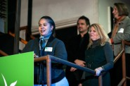 Angela Moragne, co-owner of That Salsa Lady, speaks at the Kiva City Milwaukee launch party. Listening are Wendy Baumann (center), president and CVO of WWBIC, John McWilliam, owner of Scátháin, and Martha Brown (right), deputy commissioner of Milwaukee Department of City Development. (Photo courtesy of Mark Hines Photography)