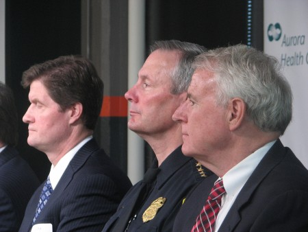 Milwaukee District Attorney John Chisholm (left), Milwaukee Police Department Chief Edward Flynn and Mayor Tom Barrett listen as members of Near West Side Partners explain the PARC initiative. (Photo by Brendan O'Brien)