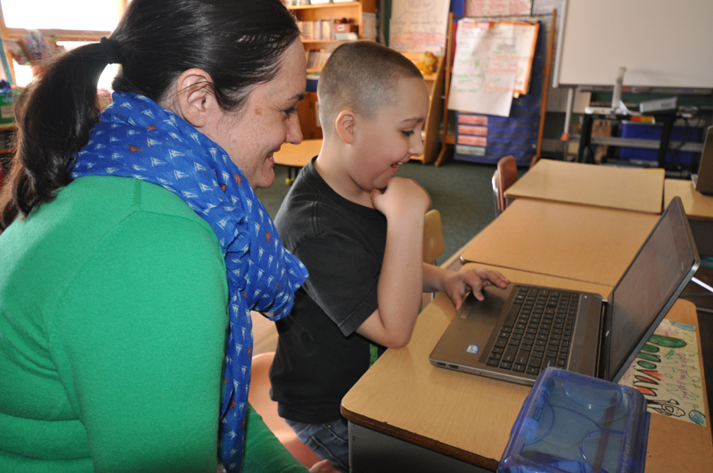 A student and teacher at MPS' Jeremiah Curtin Leadership Academy, one of the first MPS GE Foundation Schools