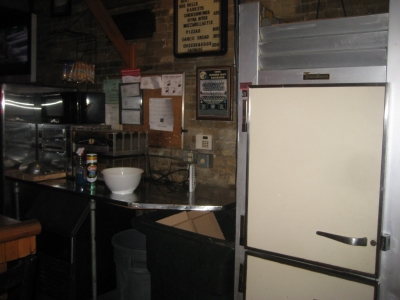There is a refrigerator along the bar, as well as two pizza ovens which get a considerable workout. Photo by Michael Horne.