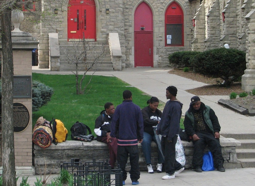 Homeless men mingle outside of The Gathering, a daily meal program held at St. James Episcopal Church, 833 W. Wisconsin Ave. Photo by Brendan O'Brien.