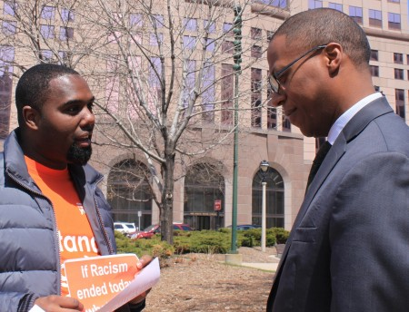 Barney Moore (right) shares his thoughts on racism with YWCA volunteer Donte Moore (no relation). Photo by Matthew Wisla.