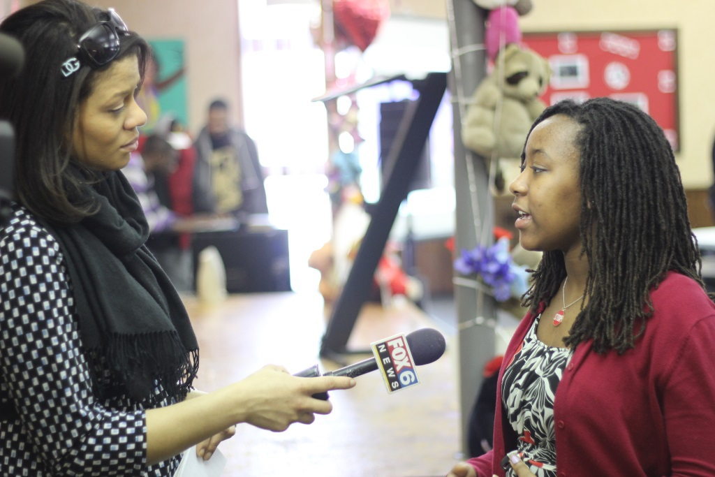 Neighborhood House Teen Leader Maya McCullough speaks with Derica Williams of Fox6 News reporter at last year's gun violence prevention summit.