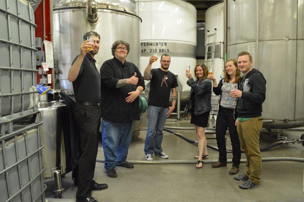 L – R:  Sprecher Sales Rep and WMSE DJ Ryan Aschebrook, Station GM Tom Crawford, Beer Creator and WMSE DJ Drew Walther, Promotions Director Sid McCain, Music Director Erin Wolf and Development Director Jay Burseth. Photo courtesy of WMSE.
