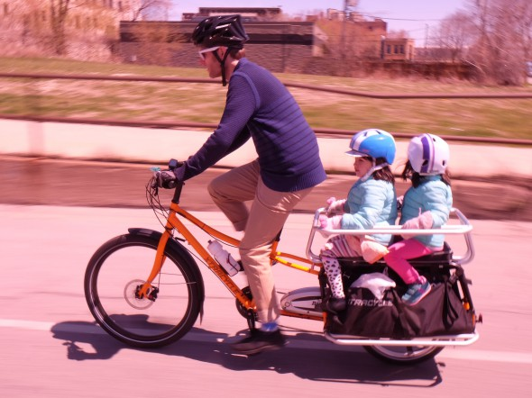 Xtracycle also makes a Bionix-powered e-assisted model. The one shown here has their nice Hooptie kid carrier and Mini Magic Carpet padded seat. (Photo by Dave Schlawbowske)