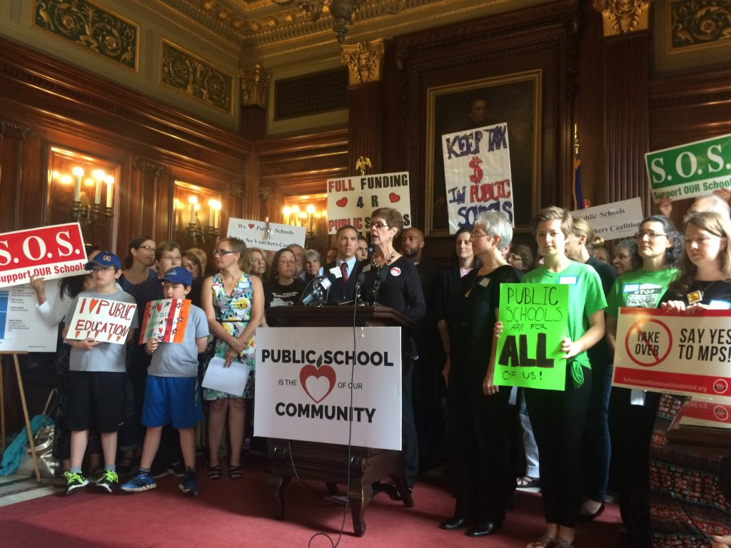 Pictured at the podium is Sandy Whisler from the grassroots group Citizen Advocates for Public Education based in Lake Mills, WI. Photo from Jennifer Shilling's office.