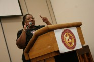 Shanyeill McCloud addresses attendees during an orientation session at the neighborhood summit. Photo by Jabril Faraj.