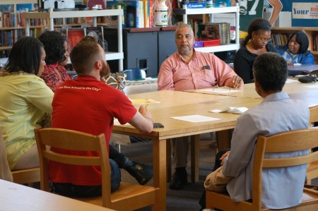 Amani resident Arthur West (center facing camera) participates in a recent planning meeting for Moody Park. Photo by Edgar Mendez)