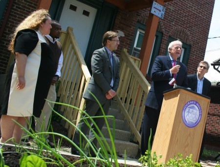 "Milwaukee Mayor Tom Barrett spoke at the Journey House Campus Housing Initiative grand opening, calling the program ""an amazing team effort."" Photo by Jabril Faraj."