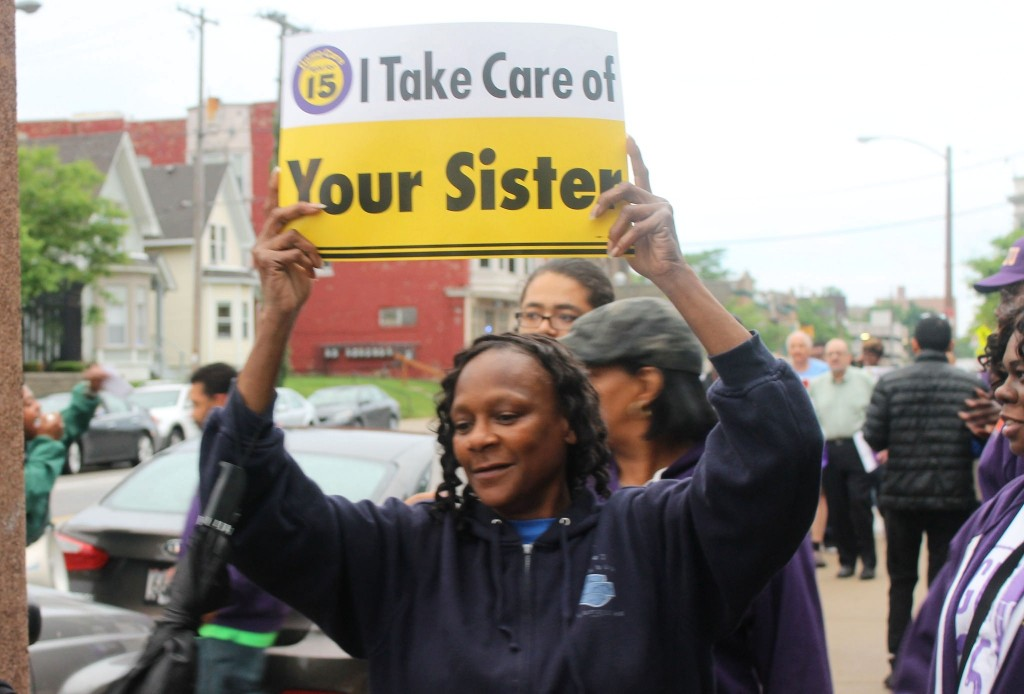 Milwaukee home care workers marched in front of the MCFI building demanding higher benefits and increased wages. Photo by Madeline Kennedy.
