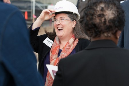 Carmen Pitre greets attendees at the Sojourner Family Peace Center groundbreaking ceremony on Oct. 1 at 619 W. Walnut St. Photo courtesy of Sojourner Family Peace Center.
