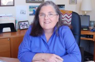 Executive Director Carmen Pitre will continue working in her office at the Germania Building until the new Sojourner Family Peace Center opens in late 2015. Photo by Andrea Waxman.