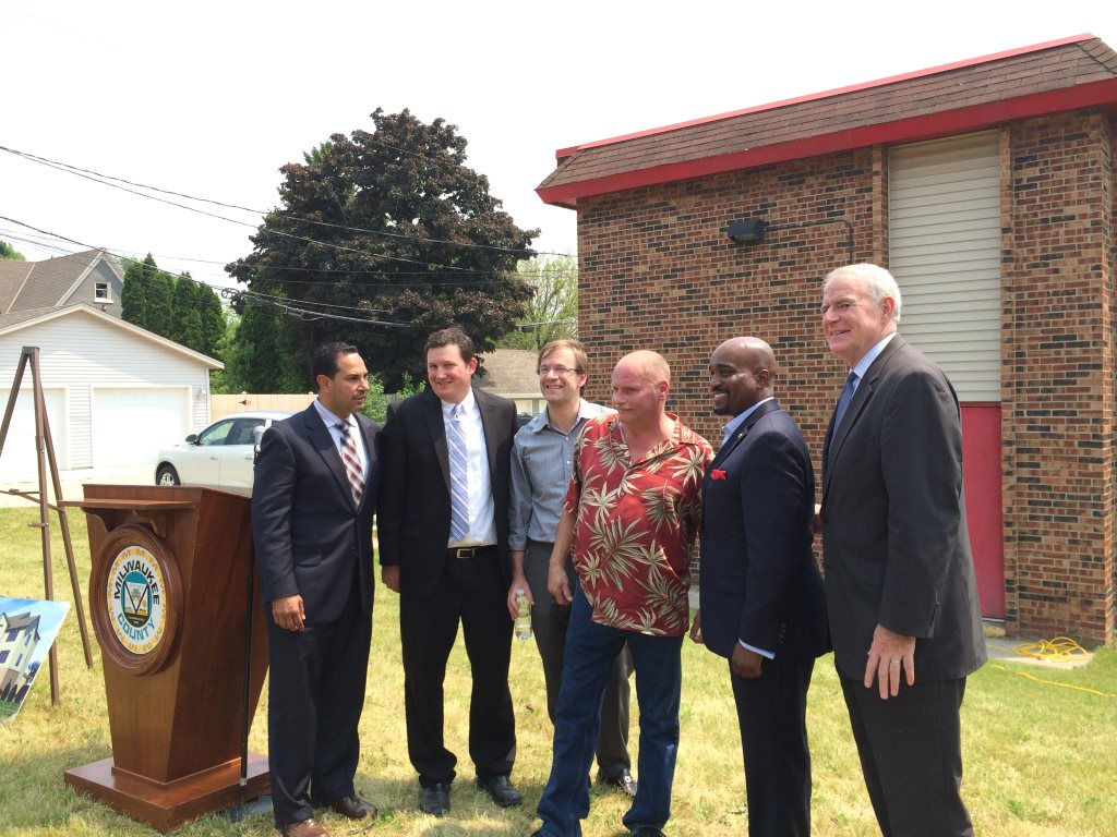Hector Colon, Jim Mathy, Chris Abele, Mark Hilton, Antonio Riley and Tom Barrett announce the Housing First plan in June 2015 at the Thurgood Marshall Apartments. Photo by Hayley Keith.