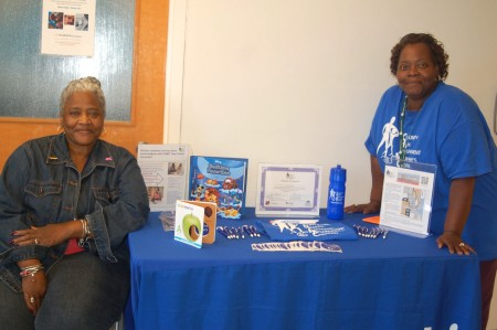 Community Forward Team members Carolyn Ramsey and Janice Harrell stand at the recruiting table. Photo by Devi Shastri.