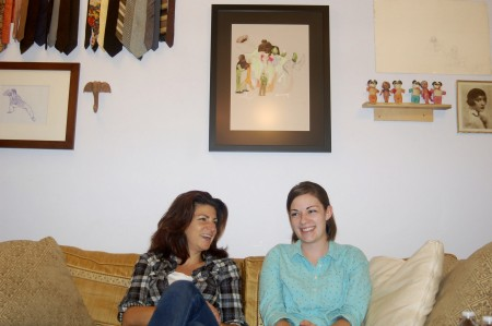 Faith Kohler (left) and producer Jessica Farrell converse in the studio space they share with other local artists in Brewer's Hill. Photo by Allison Dikanovic.