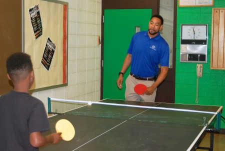 Sprewell plays a few rounds of ping-pong with middle school boys at the North Division Boys & Girls Club. Photo by Andrea Waxman.