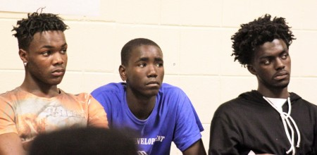 Brothers Christian (left) and Anthony (right) Robinson listen with Isaiah Lee (center) to presentations during a recent Mentor Monday meeting. Photo by Matthew Wisla.