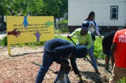 Cleveland Easley and other students work at a pocket park on 19th Street and Meinecke Avenue. Photo by Jabril Faraj.